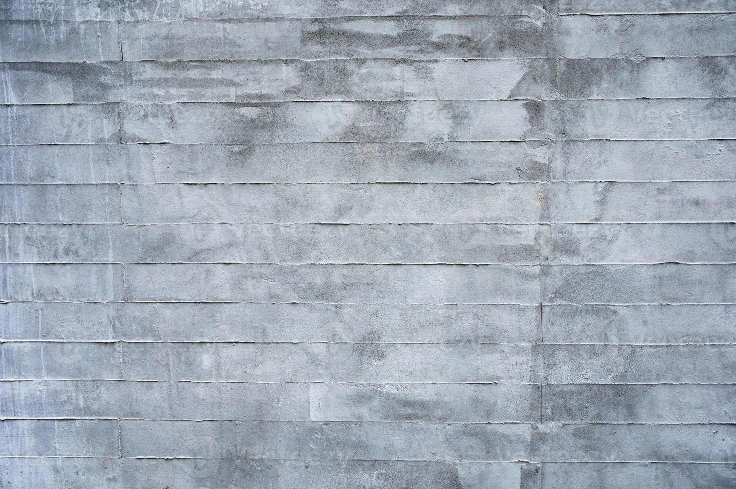Texture of grey stained cement brick block wall photo