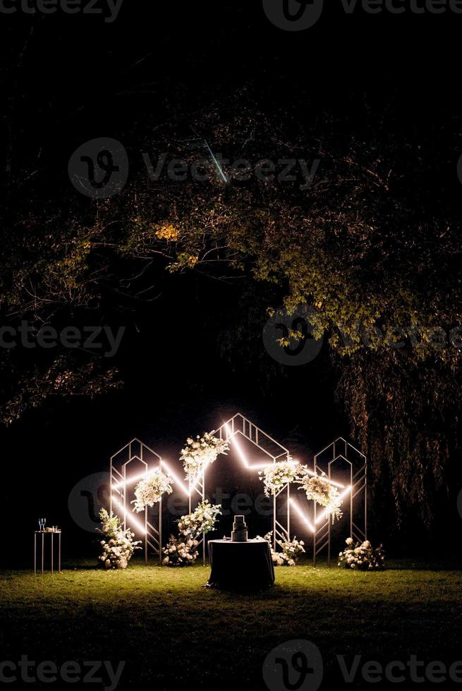 wedding ceremony area with dried flowers in a meadow photo