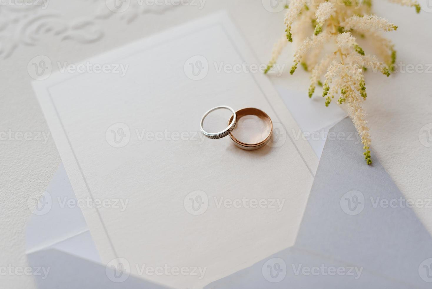 wedding rings with a gray wedding decoration photo