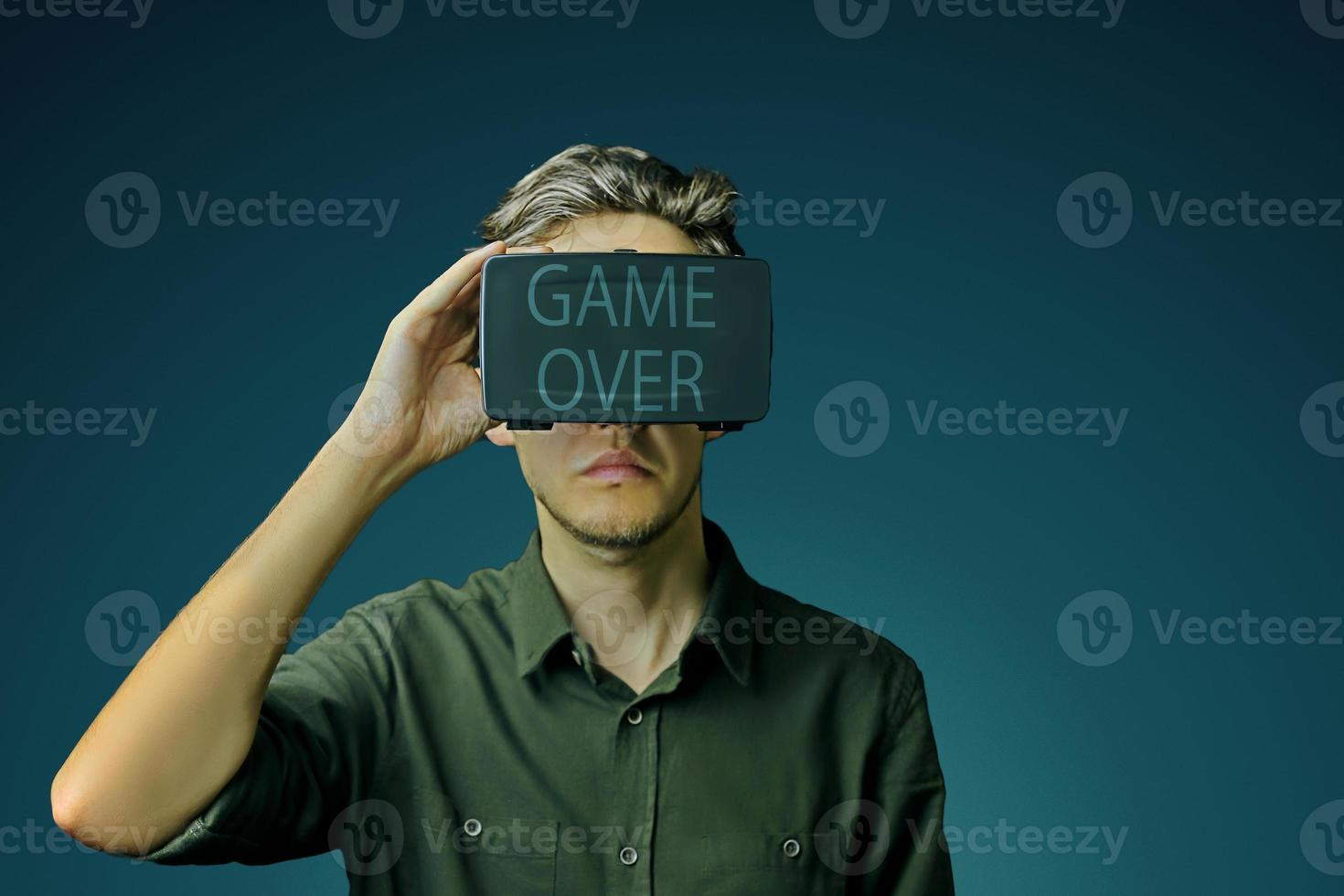 Man uses VR and game over for him photo