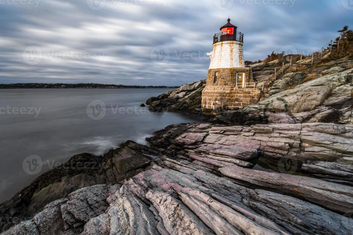 sunset in newport rhode island at castle hill lighthouse photo