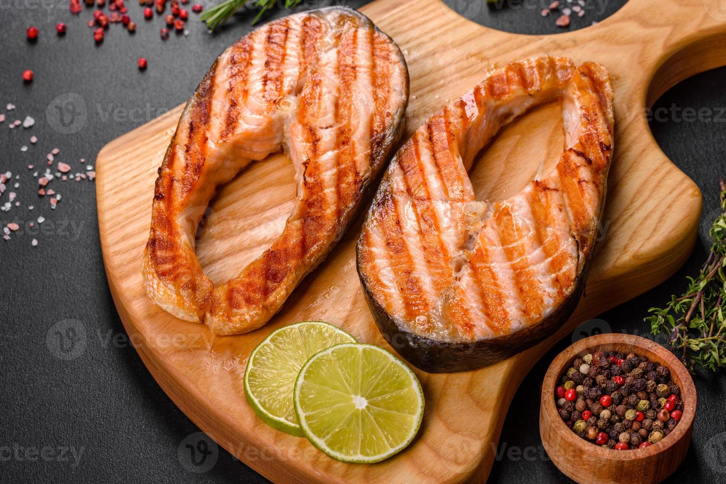 Fresh cooked delicious salmon steak with spices and herbs baked on a grill  2974856 Stock Photo at Vecteezy
