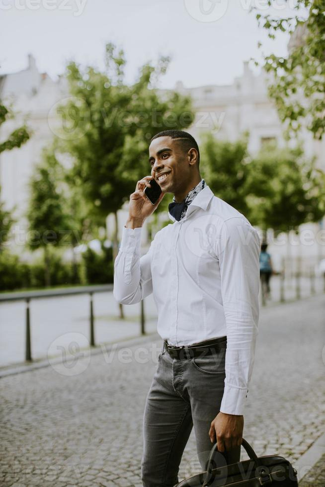 Young African American businessman using a mobile phone photo