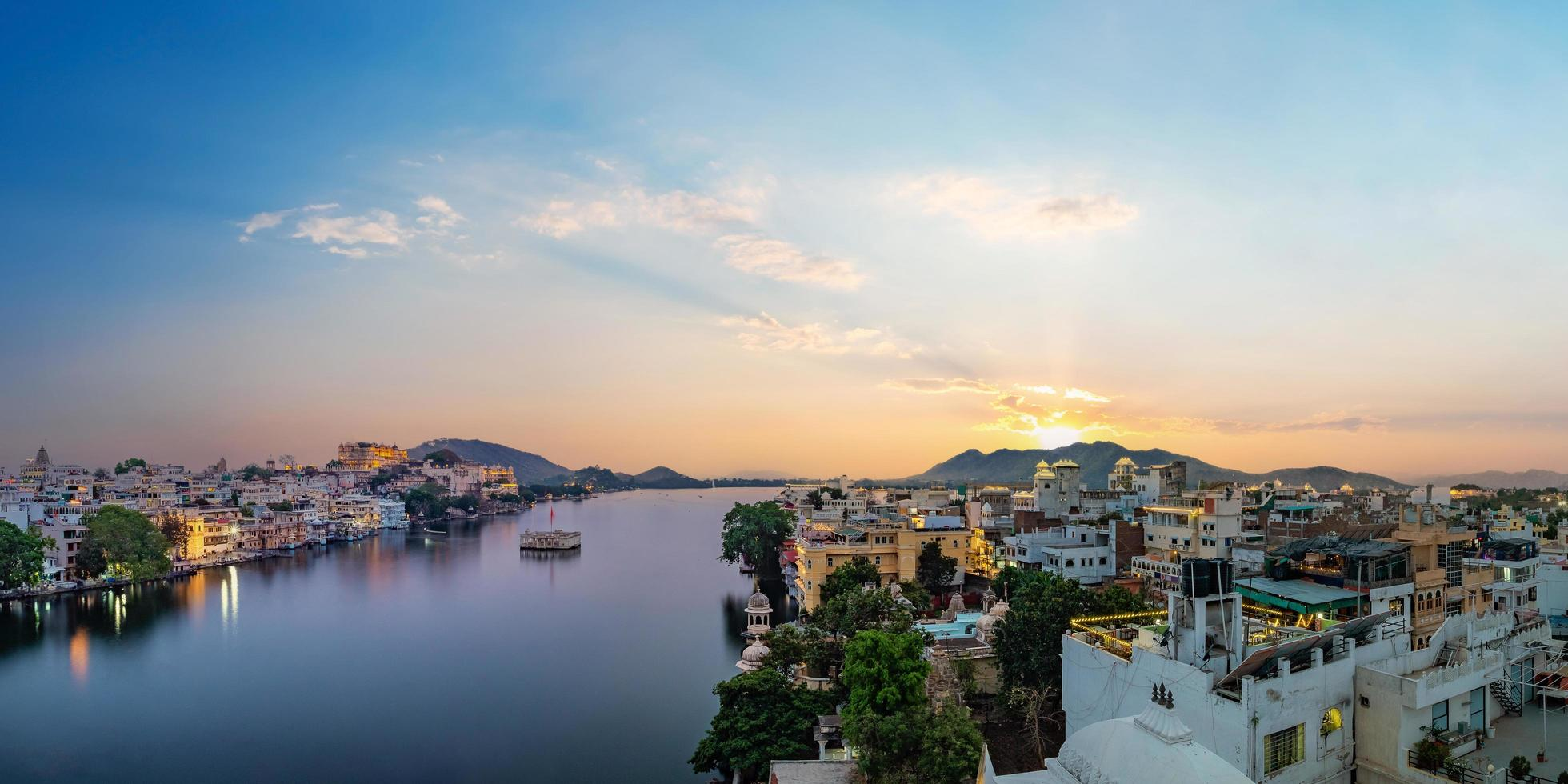 Udaipur city at lake Pichola in the evening photo