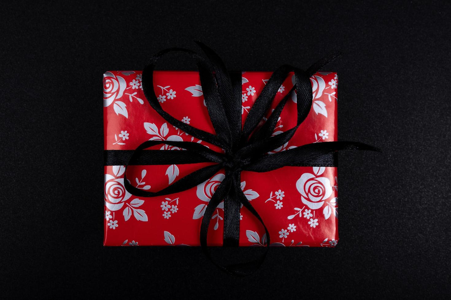 A set of gifts and surprises in bright boxes decorated with ribbons photo