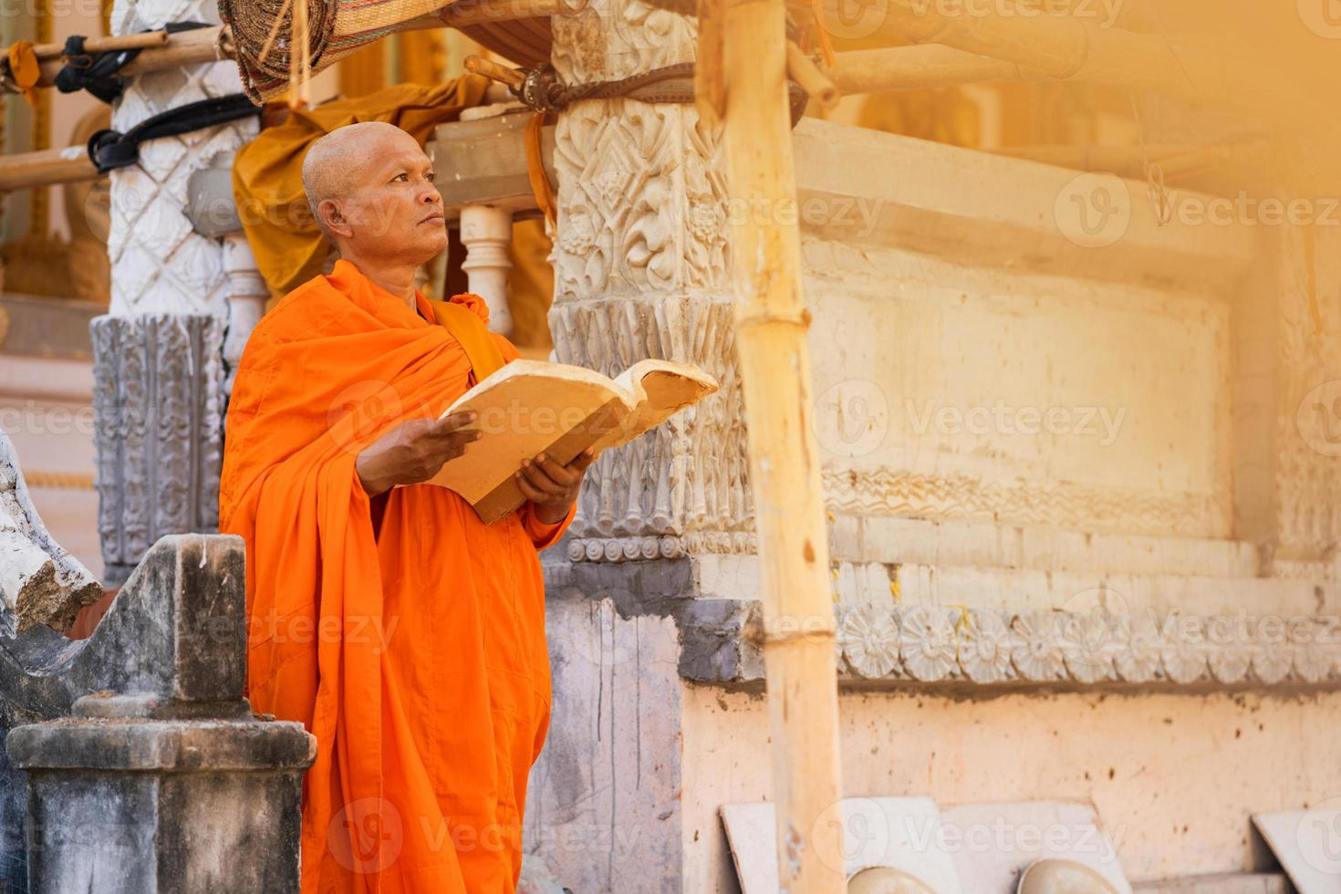 Monks in Thailand are reading books photo