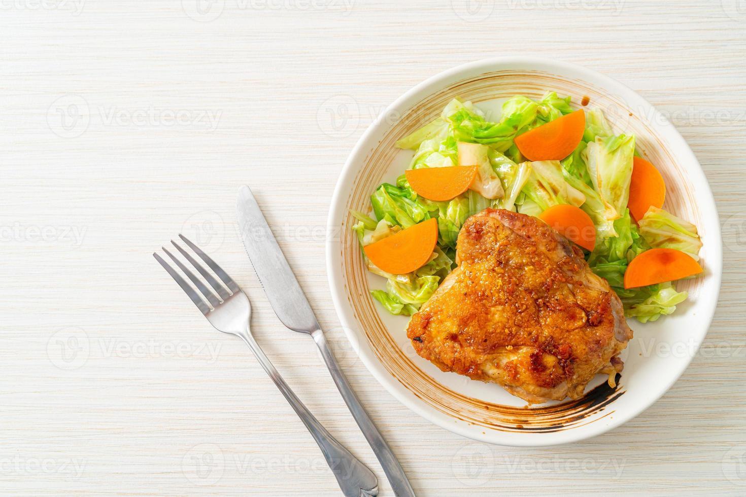 Teppanyaki teriyaki chicken steak with cabbage and carrot photo