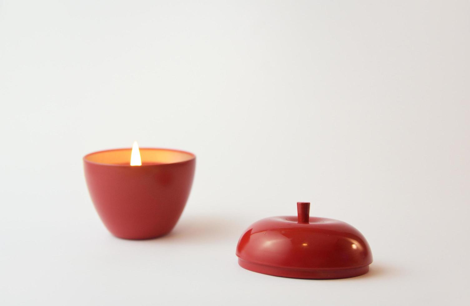 An apple-shaped red candle photo