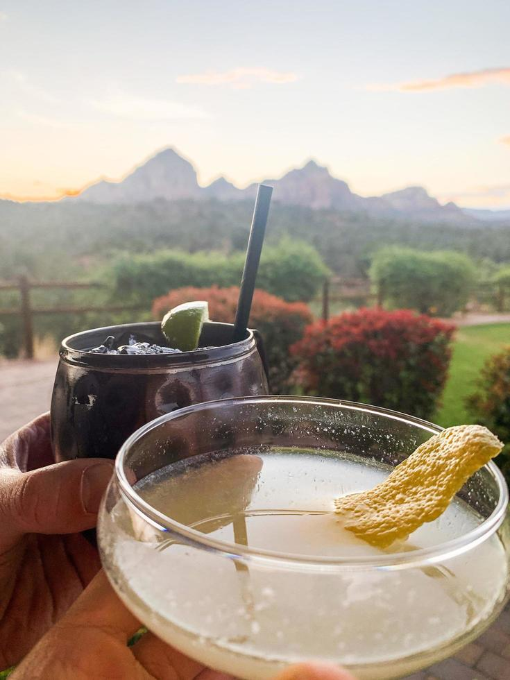 Drinks at sunset in a desert setting photo