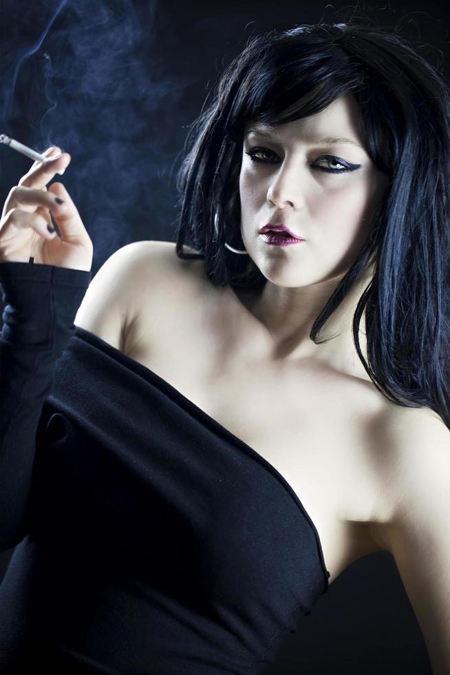 Young Beautiful Woman Smoke Cigarette photo