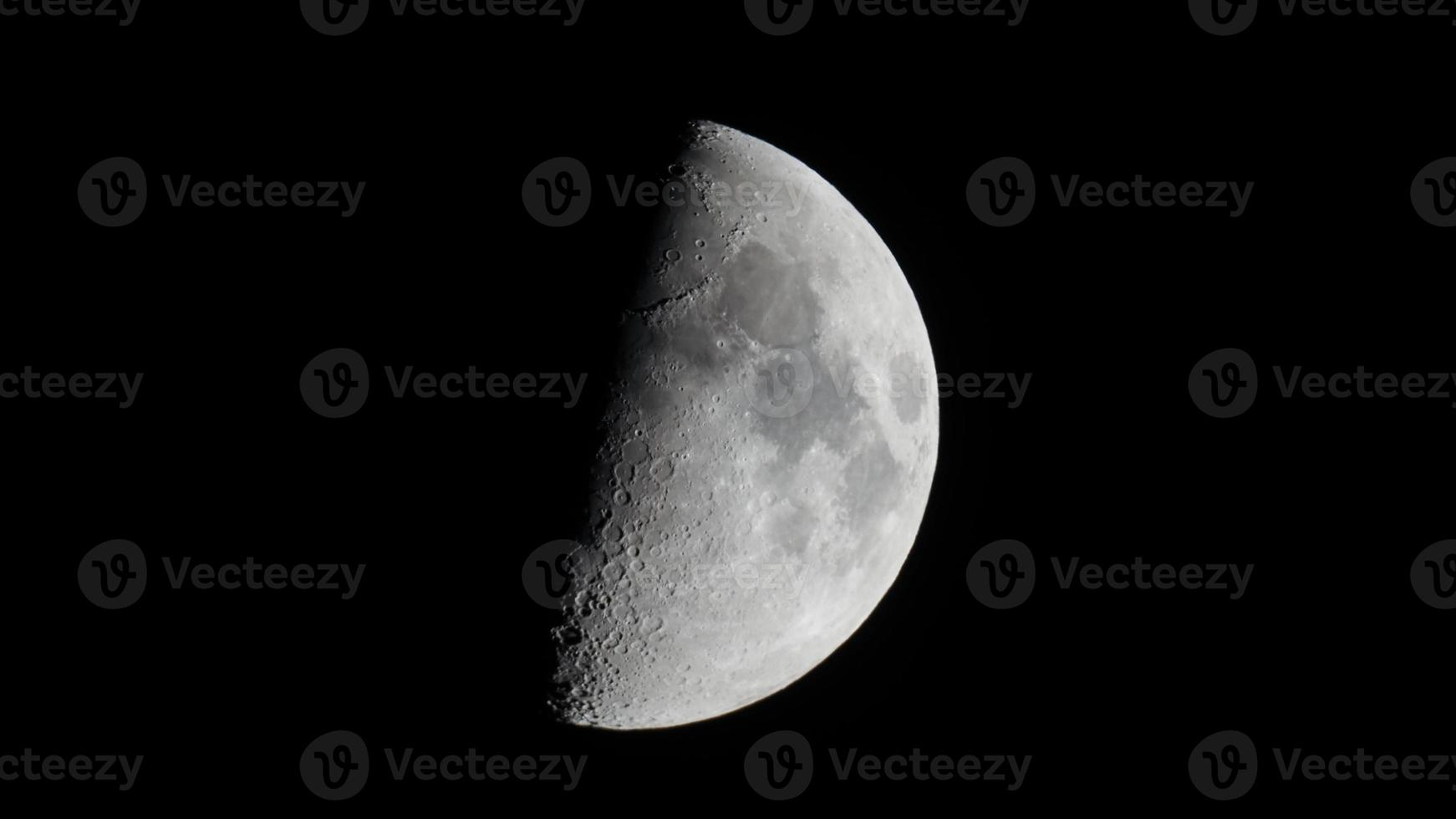 First quarter moon seen with telescope photo