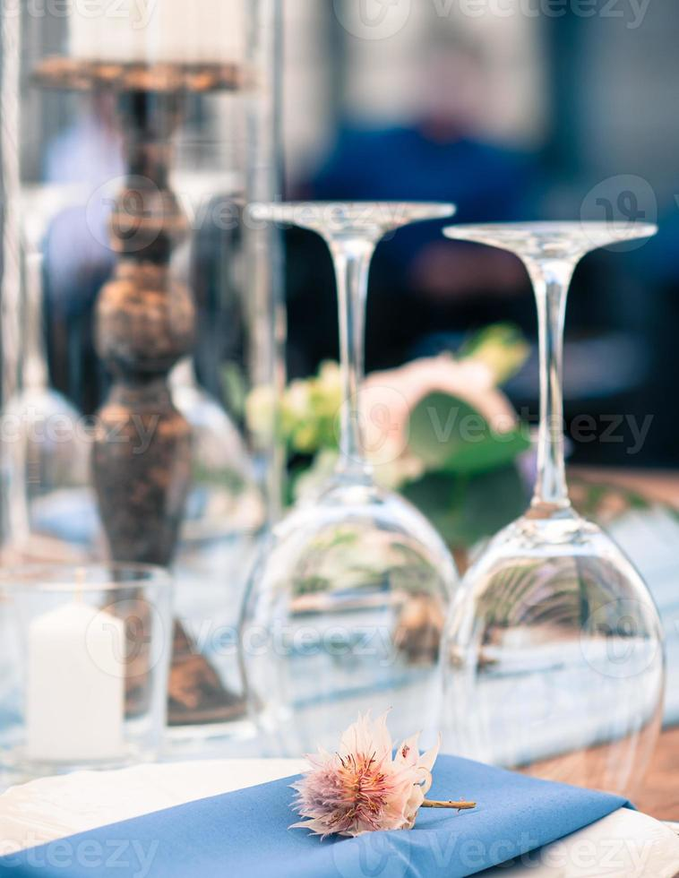 Wedding or event decoration table setup, summer time, outdoors photo