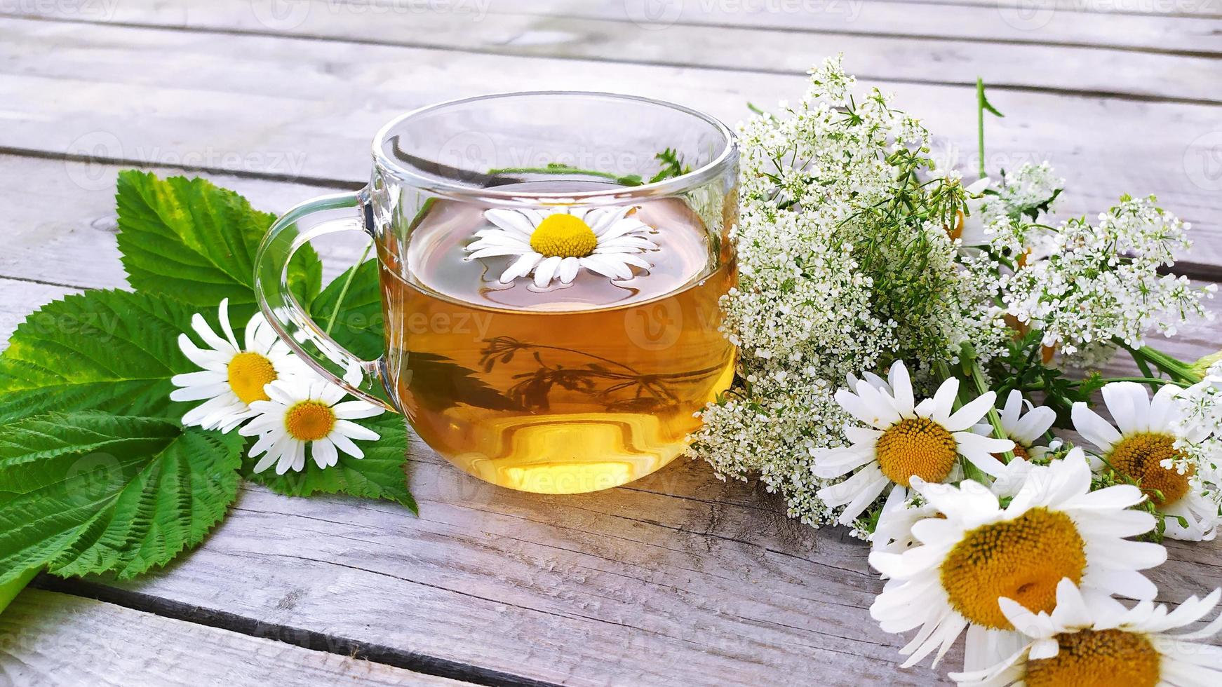 Chamomile tea in a glass cup. A transparent cup with photo