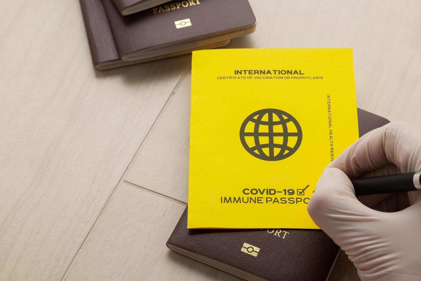 Hand signing vaccine passports photo