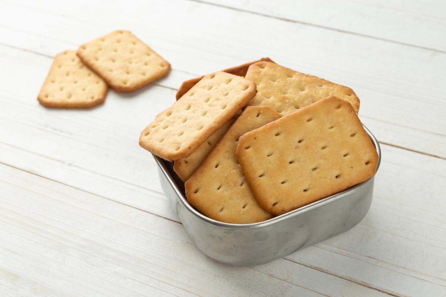 Cracker cookies in a stainless steel bowl photo