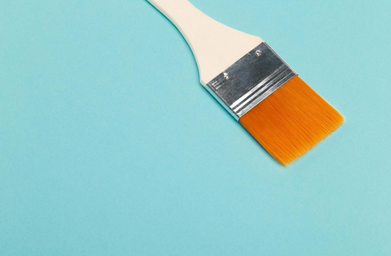 paintbrush isolated on blue background photo