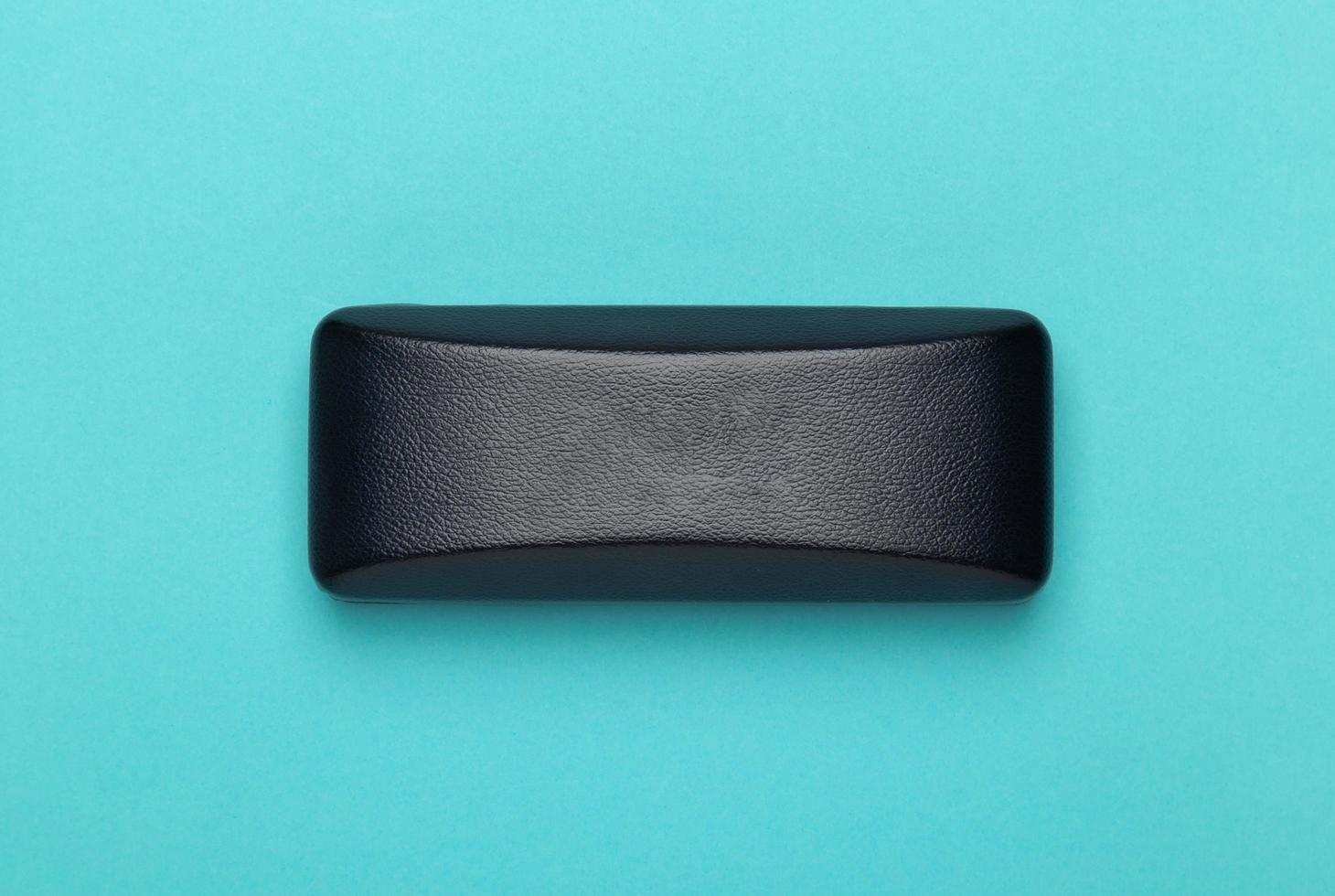 Sunglasses box on blue background photo