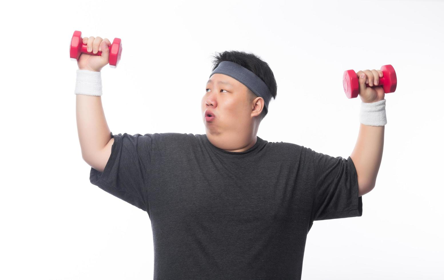 Young fat man exercise with dumbbell photo