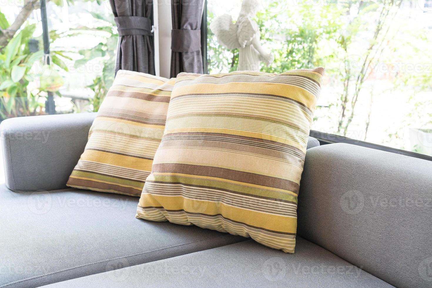 Beautiful pillow on sofa decoration photo