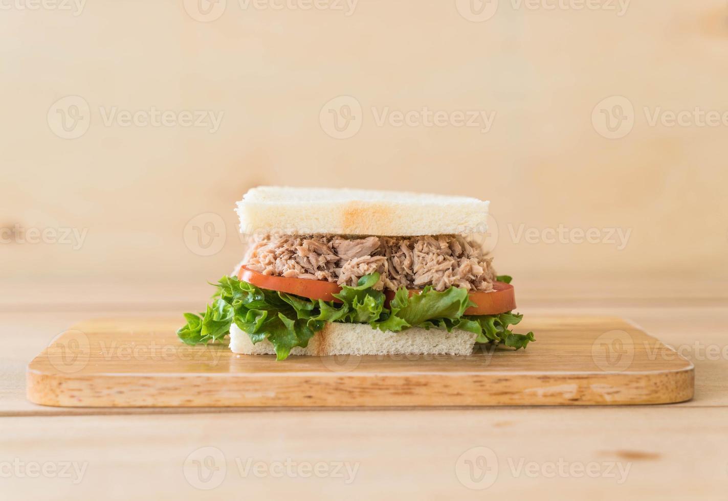 Tuna sandwich on wood board photo