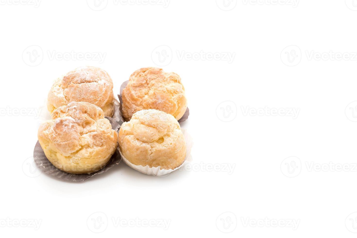 Cream puff on white background photo