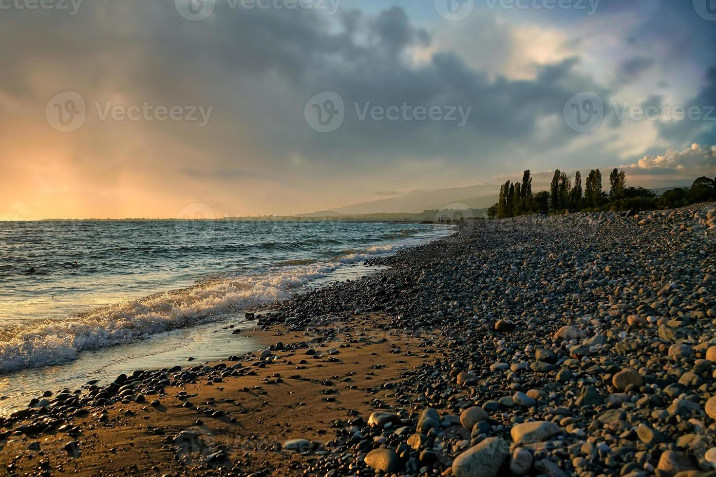 Seascape with a beautiful sunset on the background of the sea photo