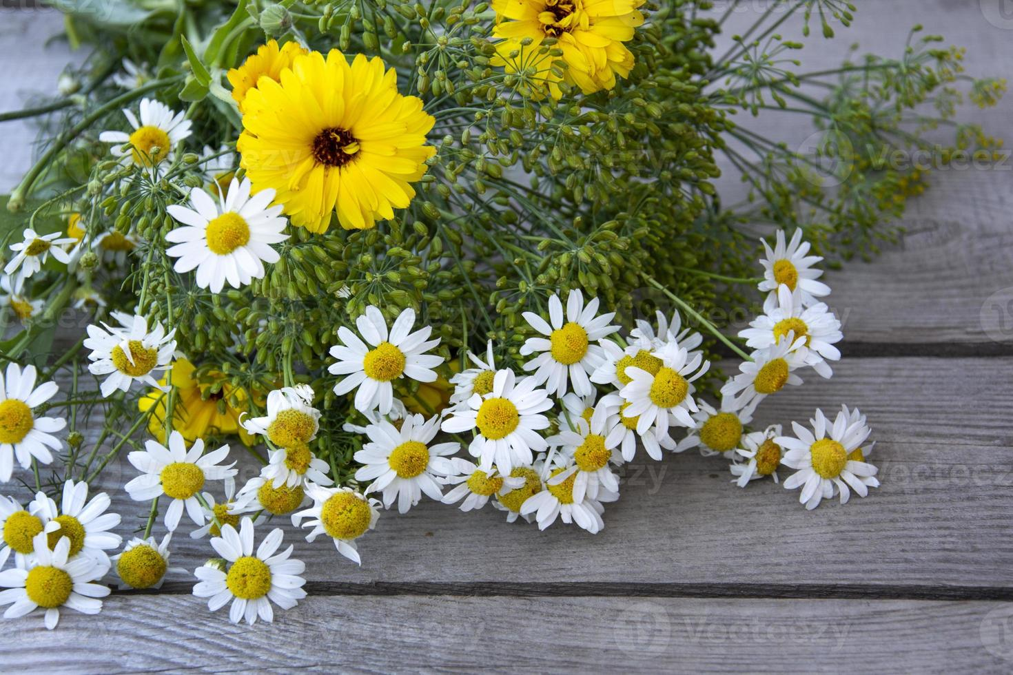 Bouquet of flowers on a wooden background photo