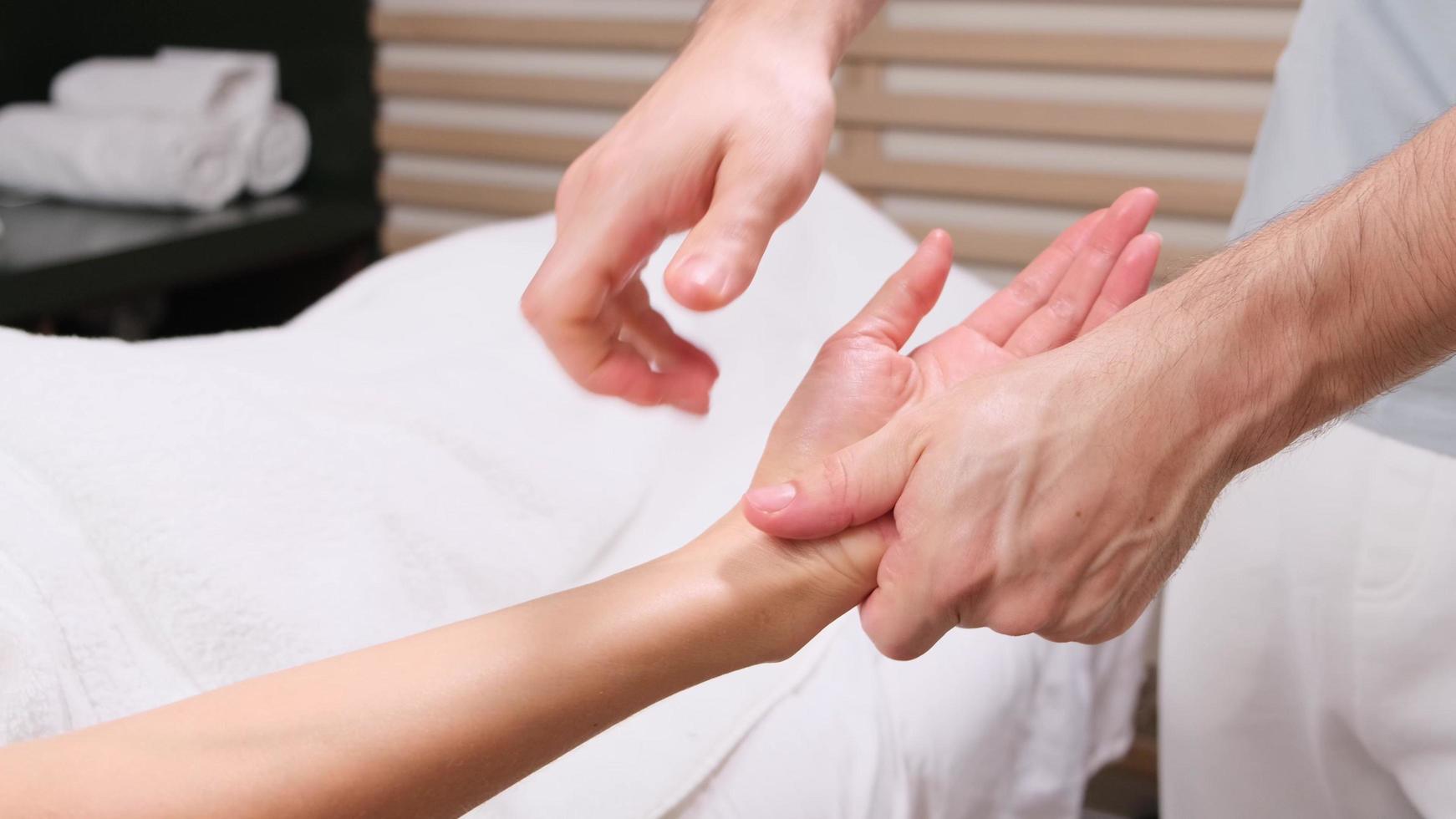 Procedure hands massage in the spa salon.Hand Care in the beauty salon. Massage the fingers and wrist in a spa salon. Spa manicure procedure. photo
