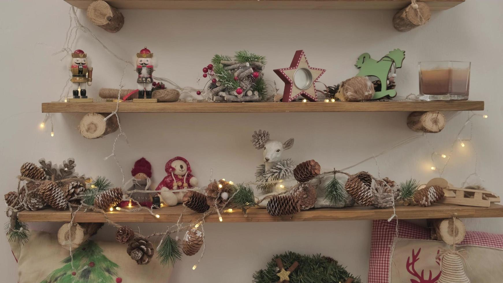 A room with Christmas decorations and toys. on the wooden shelfs are souvenirs and decorations photo