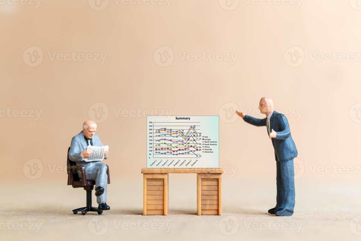 Business people looking at analyst graph on screen background photo