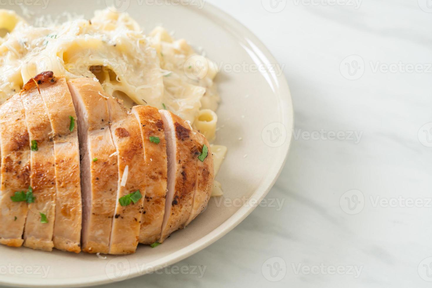 Homemade Fettucine pasta white creamy sauce with grilled chicken photo