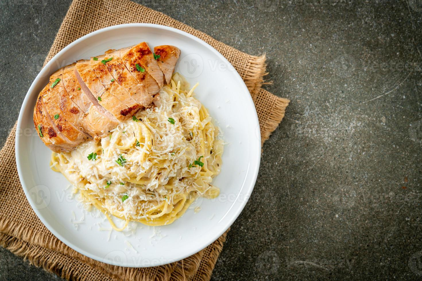 Homemade spaghetti white creamy sauce with grilled chicken photo