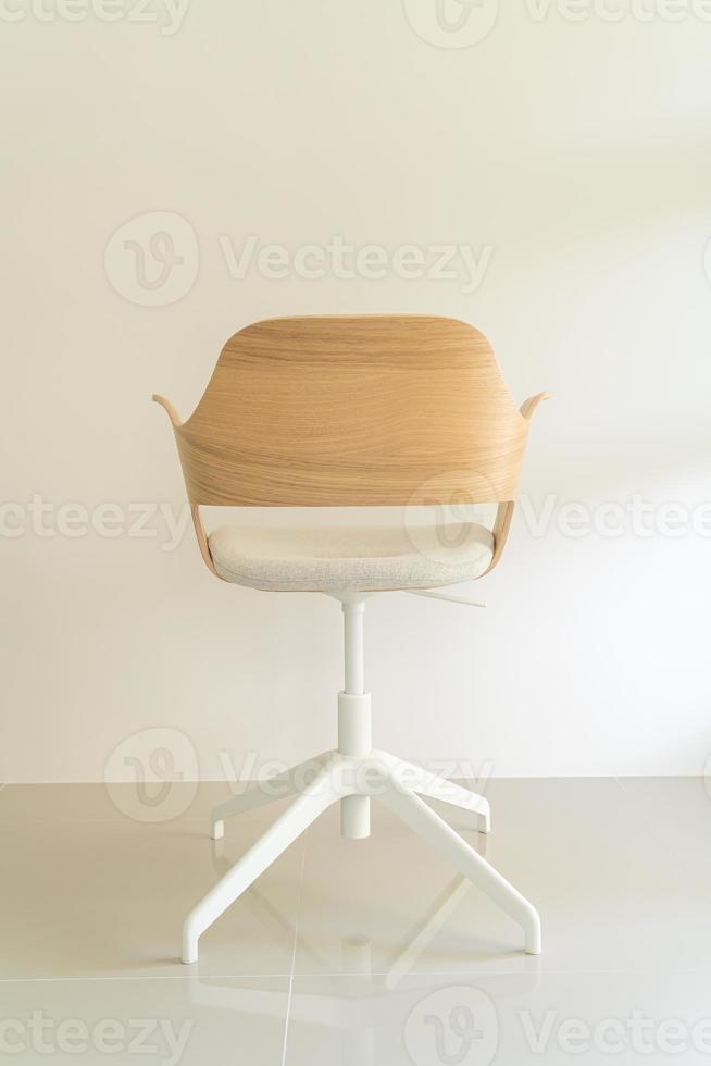 Wood chair with grey fabric seat photo
