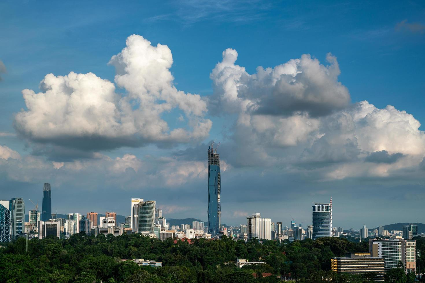 Kuala Lumpur, Malaysia 2021- Kuala Lumpur city skyline in the evening with dramatic clouds during sunset, taken from viewpoint in Bukit Tunku, Kuala lumpur photo