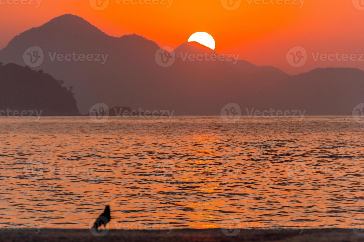 Sunrise on Copacabana beach in Rio de Janeiro Brazil. photo