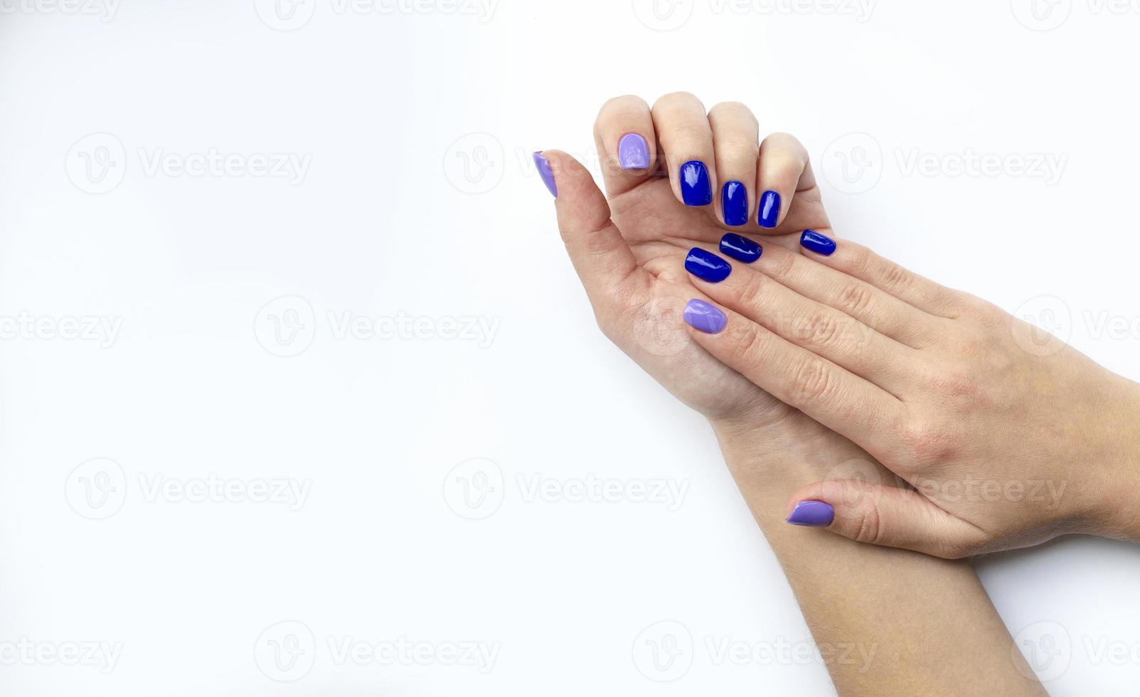 Stylish trendy women's manicure. Blue and lilac photo