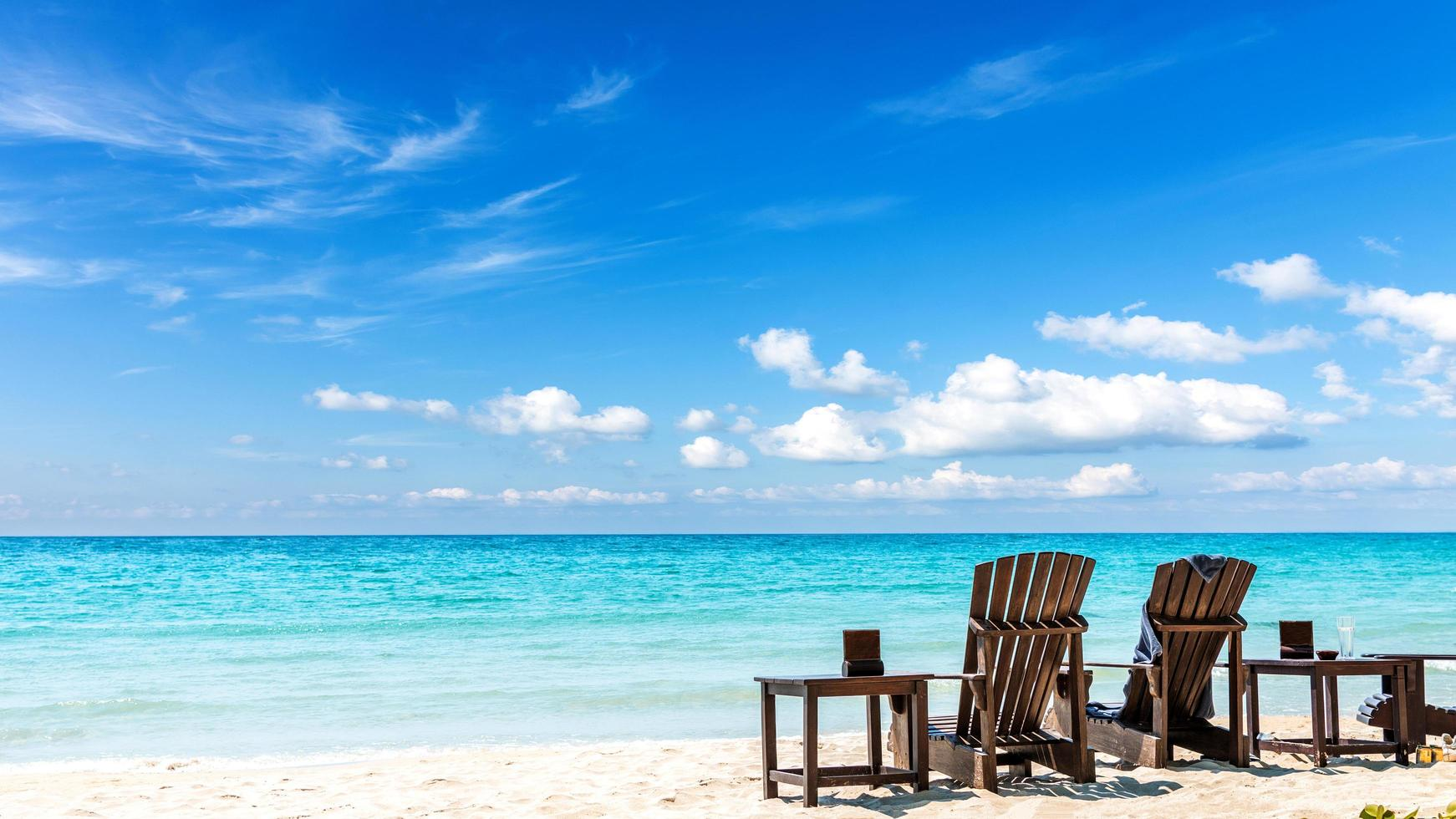 Summer vacation background with deckchairs photo