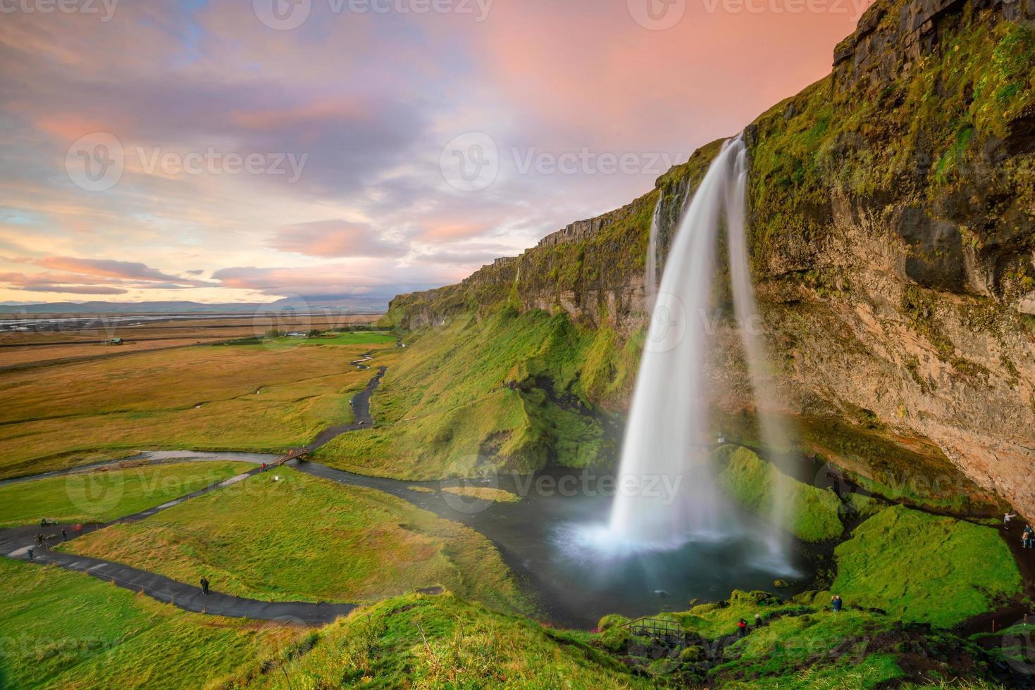 Seljalandsfoss waterfall at sunset in Iceland photo