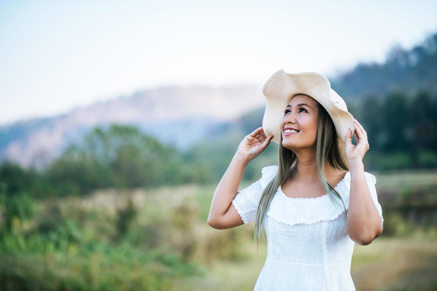 Woman in the hat happiness in the nature photo