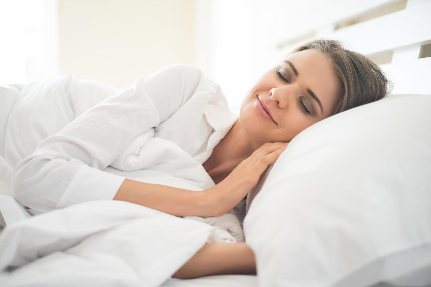 Beautiful Young woman sleeping in bed photo