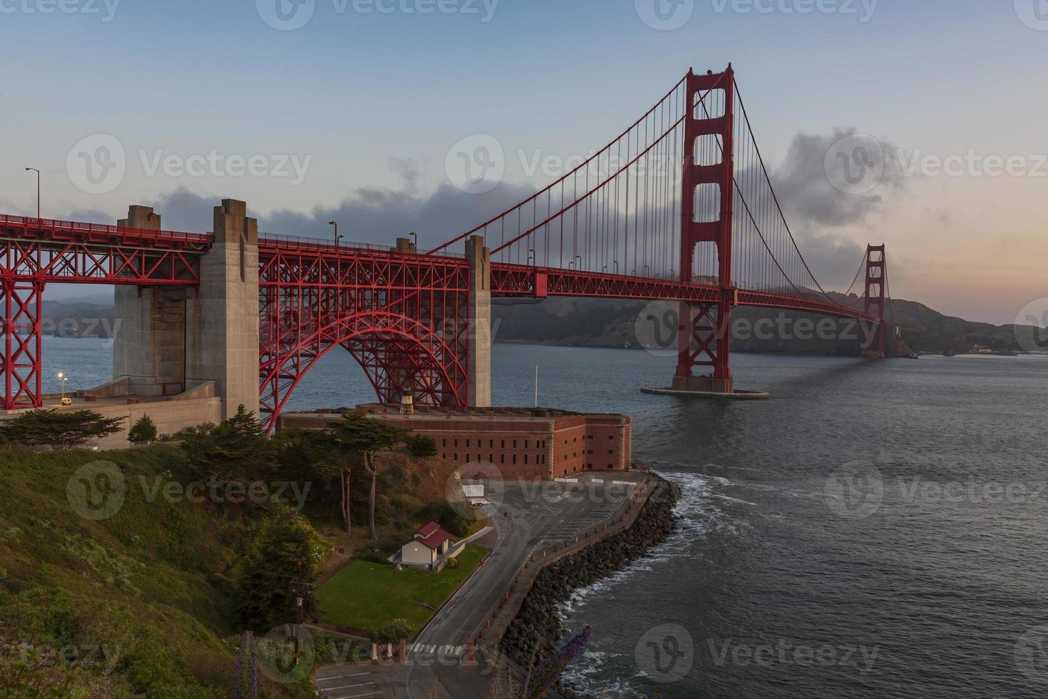 Golden Gate Bridge illuminated at sunrise, San Francisco, USA photo