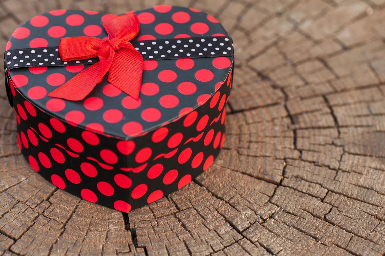 Heart Shape of Gift Box on Wood Trunk photo