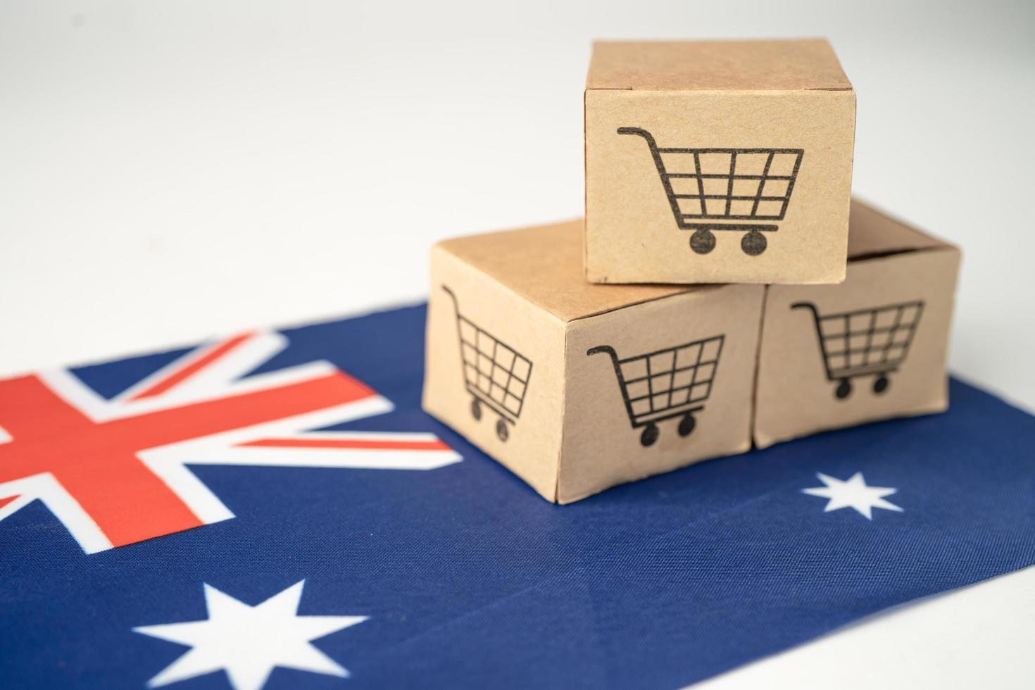 Box with shopping cart logo and Australia flag, Import Export photo