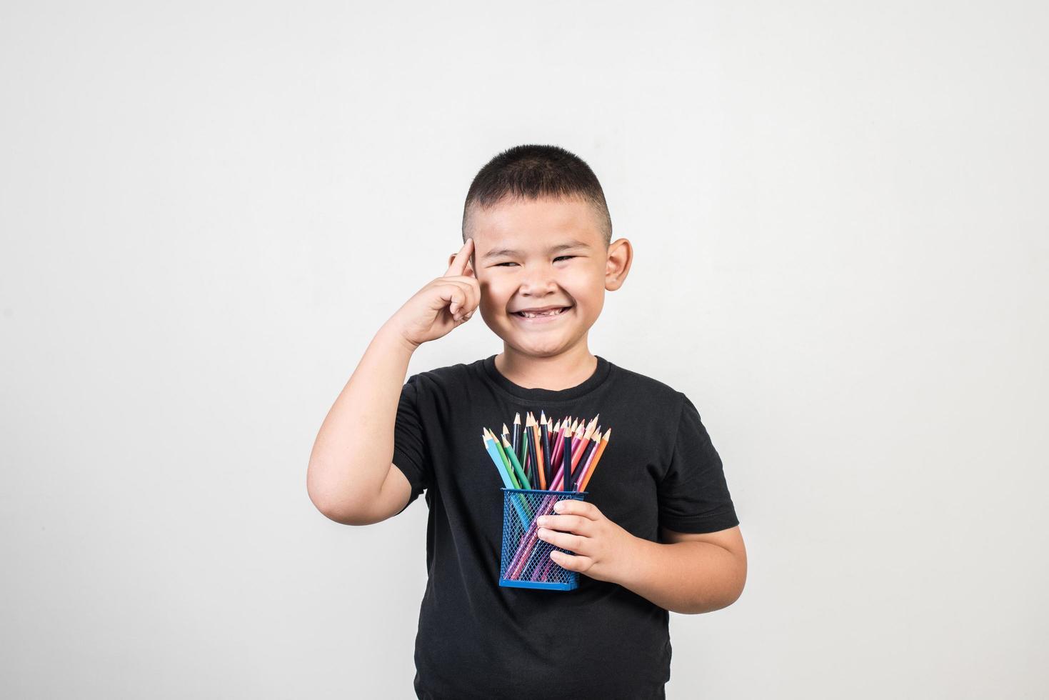 Educatoin boy smiling in studio shot. photo
