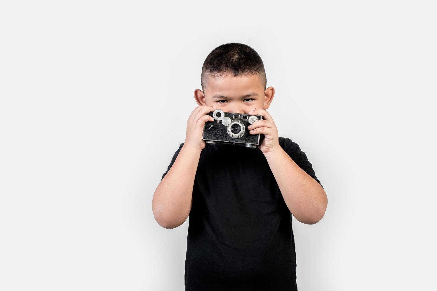 fotógrafo de niños tomar una foto. foto