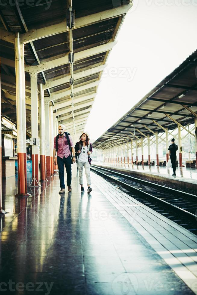 Young hipster couple in train station. photo