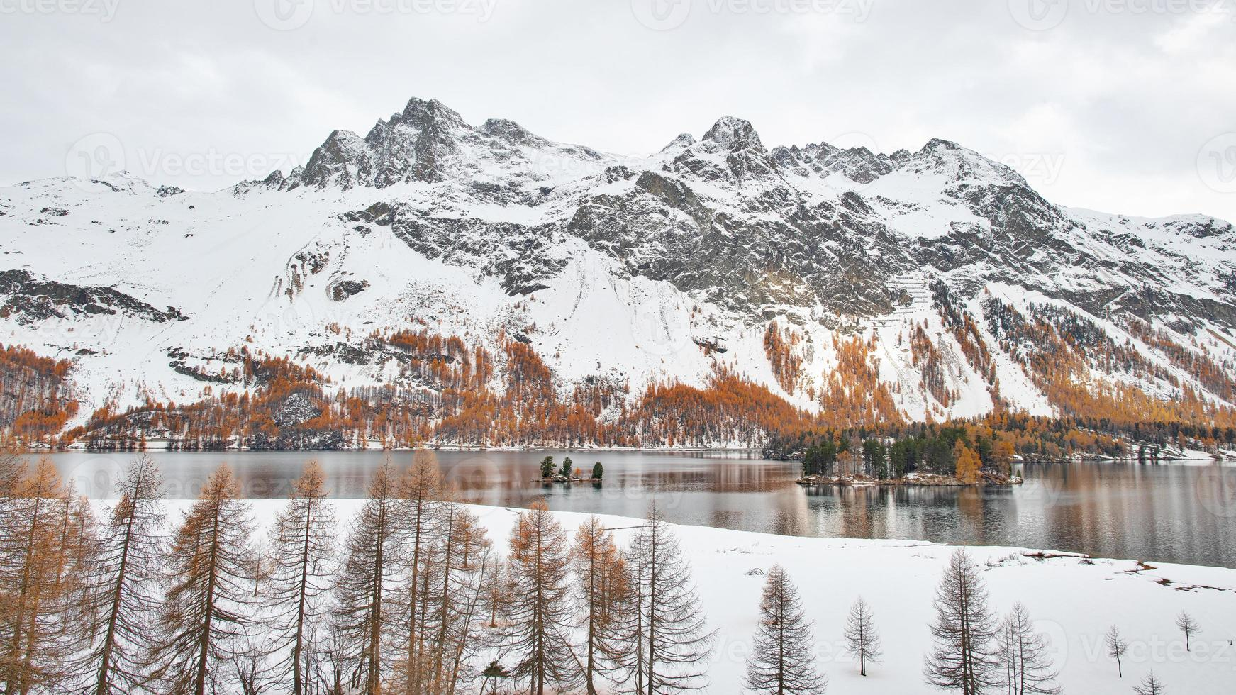 Panoramic landscape of the Engadine valley on the Swiss Alps photo