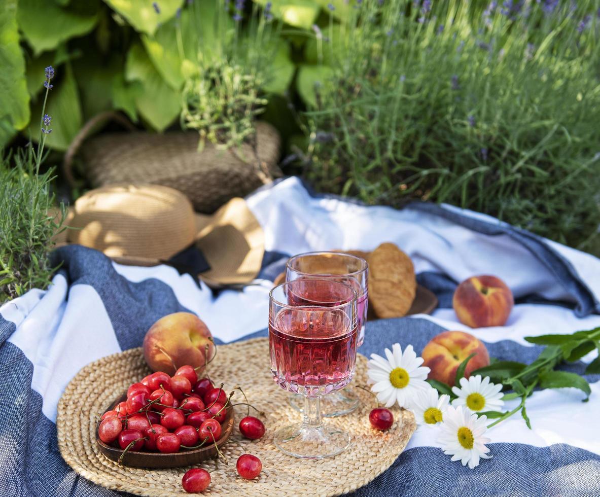 Set for picnic on blanket in lavender field photo