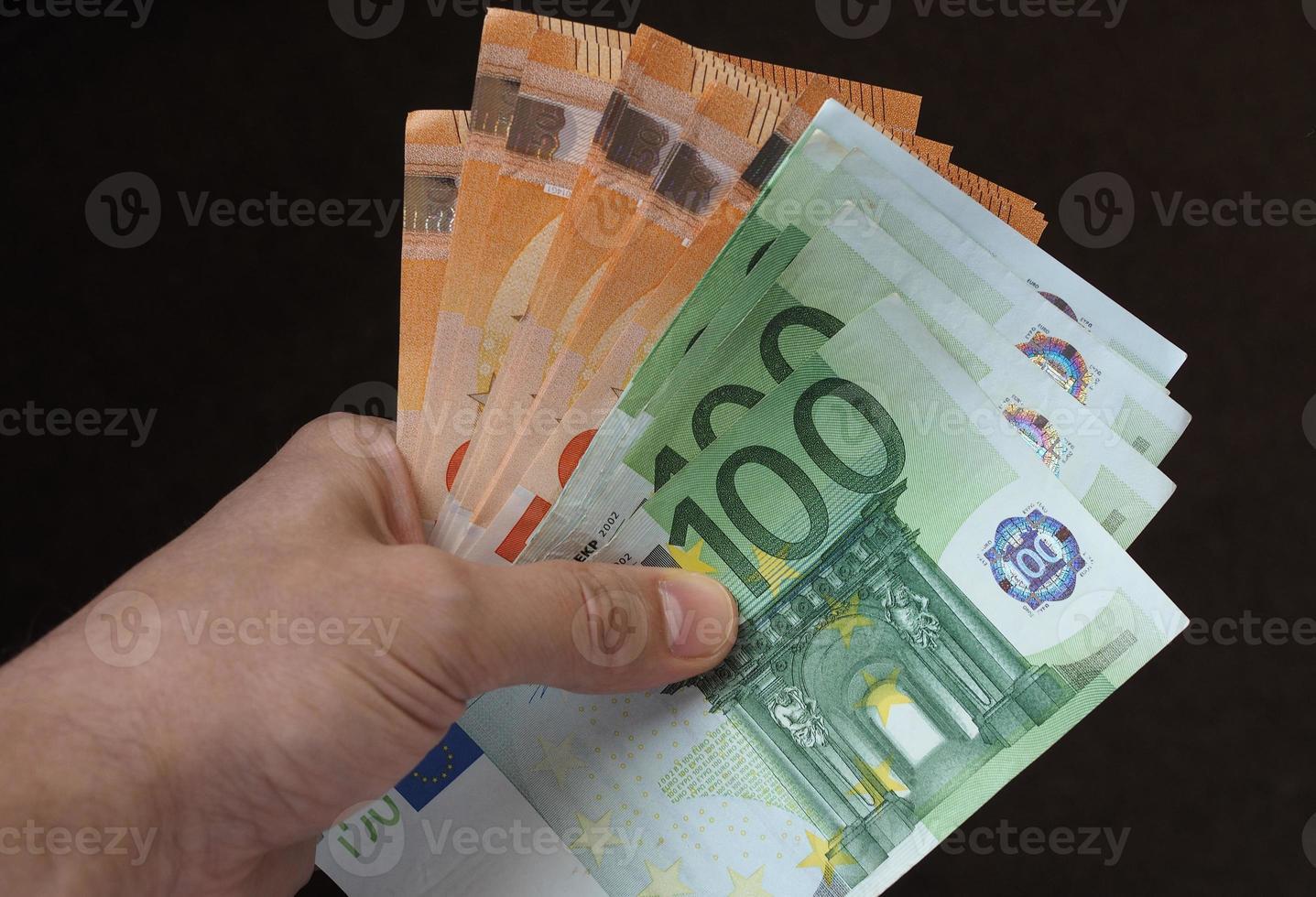 Hand with Euro notes, European Union photo