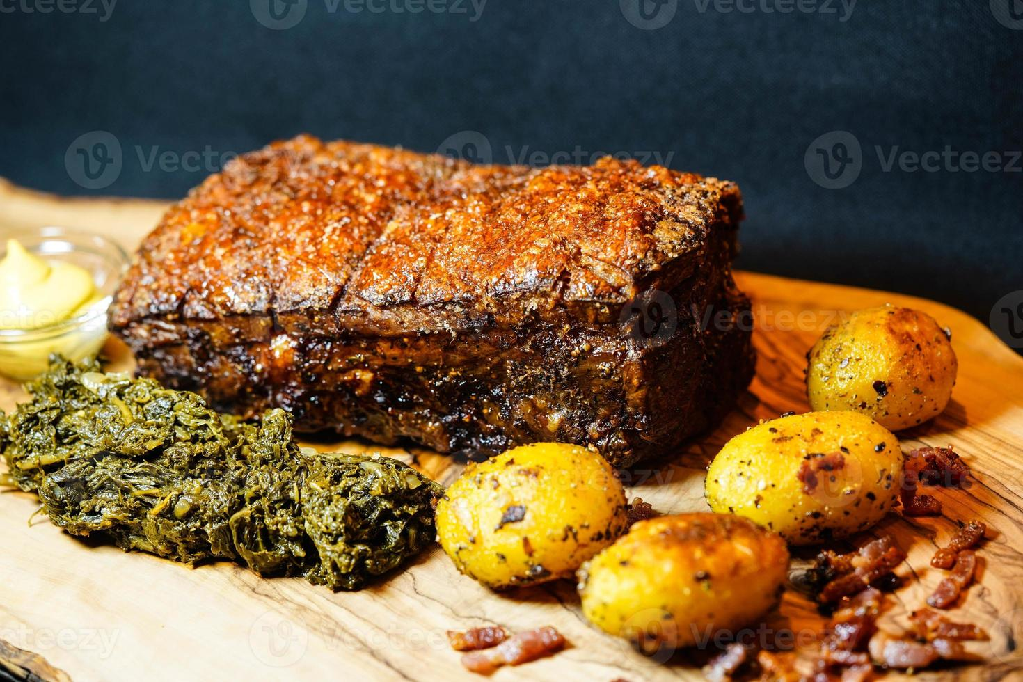 Pork royal and curly kale on olive wood photo